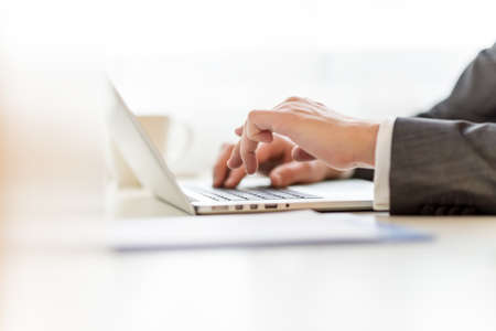 Closeup of lawyers hands typing legal document on laptop computer. Stock Photo