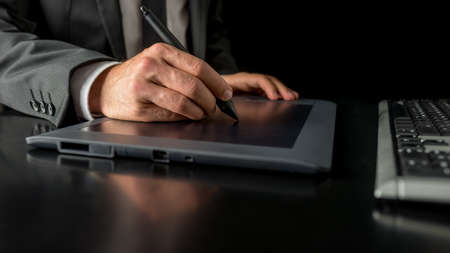 stylus pen: Closeup of male fashion designer sketching and drawing with a stylus pen on graphic tablet. Stock Photo