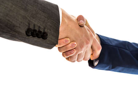 conclude: Businesspeople, a man and woman in jackets, shaking hands to conclude a business arrangement, in partnership, greeting or congratulations, close up view of their hands over white.