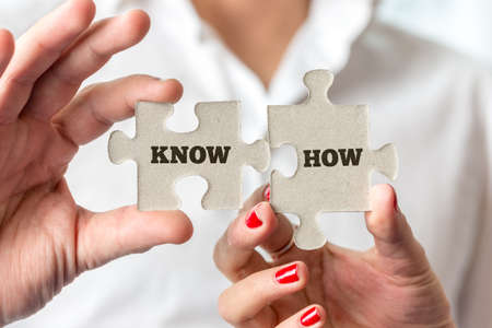 know how: Close up Businessmen Hands Holding Puzzle Pieces with Conceptual Know How Texts.