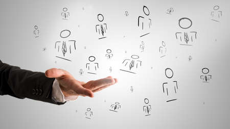 Customer managed relationship concept with a male hand presenting random people icons. Фото со стока