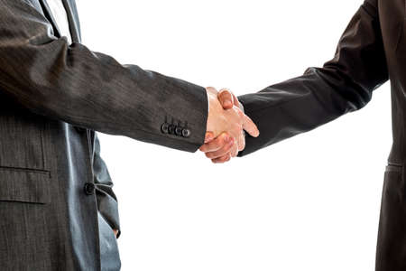 politicians: Closeup of two businessmen, lawyers or politicians shaking hands to celebrate a successful agreement with one of them holding the other hand in his pocket. Isolated over white background.
