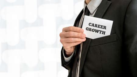 persoonlijke groei: Closeup of career adviser taking his business card out of a jacket pocket. Conceptual of personal growth and fulfillment of ones business aims and ambitions. Stockfoto