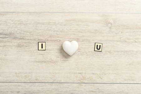 Romantic I Love You message on wood with a central white ornamental heart and copy space below for a Valentine greeting to your sweetheart. Zdjęcie Seryjne