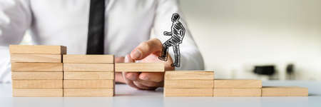 Wide view image of hand drawn shape of a businessman walking up the wooden steps supported by male hand. Conceptual of business teamwork and collaboration. Stock Photo - 113035014