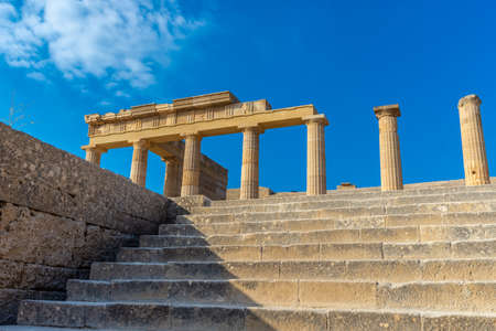 View from below from the stairs of ancient Greek pillars of Lindos acropolis Rhodes. Reklamní fotografie