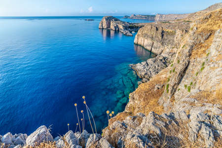 View from the top of the cliff of a beautiful blue sea and coastline of the island of Rhodes, Greece.