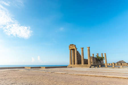 View of an ancient pillars of the acropolis of Lindos under beautiful hot summer sky. Reklamní fotografie