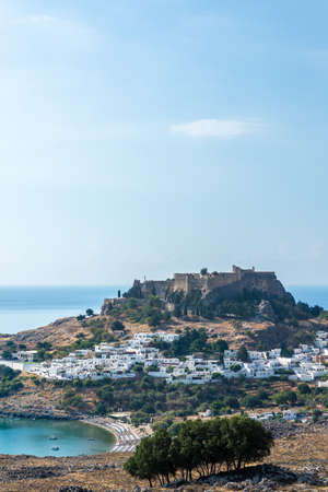 View of the acropolis of Lindos above the Lindos village on a hot summer day. Reklamní fotografie