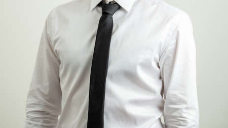 Front view of businessman torso in a white shirt and black tie. Over grey background. Archivio Fotografico - 126277793