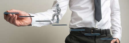 Wide view image of businessman drawing steps on virtual interface for a silhouetted man to walk up.
