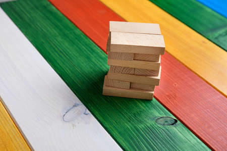 Wooden pegs over colorful wooden background, conceptual image. Imagens