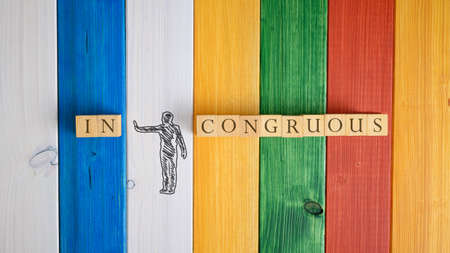 Top view of a hand drawn silhouette of a man pushing away letters IN
