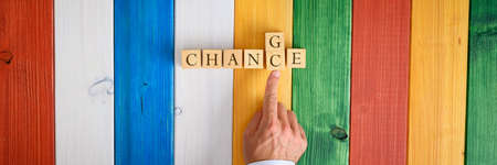 Male finger replacing letters C and G in a word Chance spelled with