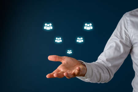 Conceptual image of customer support with male hand under a white glowing people icons floating on visual interface over blue background.