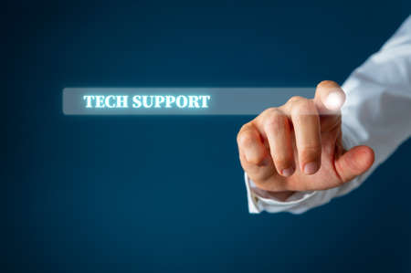 Male finger pointing at a search bar on virtual interface with Tech support words in it. Over navy blue background.