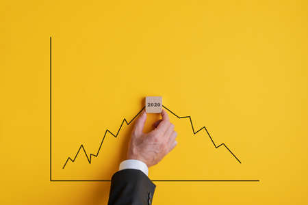 Broker predicting recession in 2020 due to global corona virus pandemic. Stock Photo