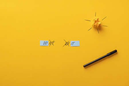 Dont quit sign changing into a Do it sign spelled over yellow background in a conceptual image.