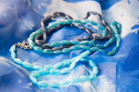 blue beads on a background of blue silk
