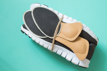 Running shoes with orthopedic insoles. For sport and fitness. Neutral background. Top view.