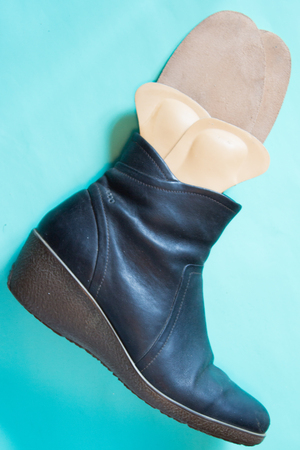 Leather black boots with orthopedic insoles.. Neutral background. Top view.