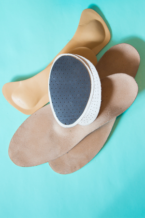Orthopedic insoles. For sport, fitness, everyday life. Neutral background.