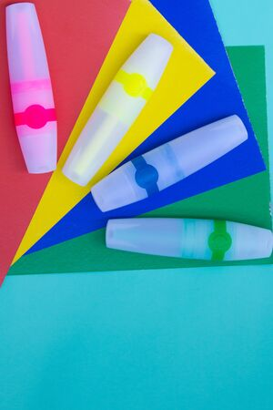 Bright green, yellow, blue,red markers or felt pen on sheets of colored paper. Stock Photo