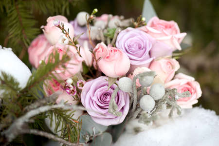 winter bouquet with large roses in purple tint