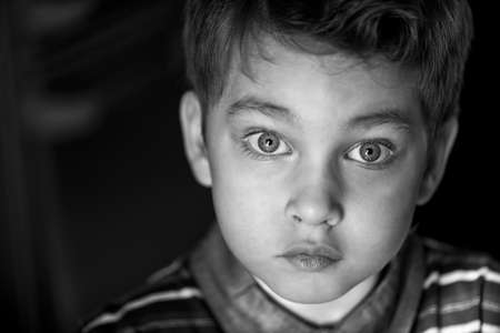 stumped: A little boy with big beautiful eyes and a stumped Stock Photo