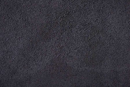 napped: Photo black suede texture close up.  May be used as the background.