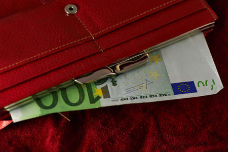 euro notes: European Euro Notes in a Red Purse Stock Photo