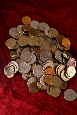 fluctuate: A lot of Russian coins on a background of red suede