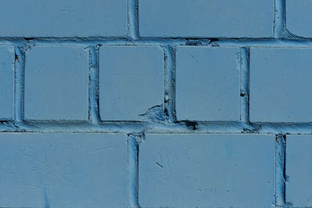 stonemason: Brick wall. The brick wall painted in blue. Stock Photo