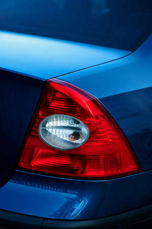 tail light: Red tail light on blue car. Detail Stock Photo