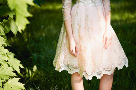 pleasantness: A female figure in a lace dress. Only the body Stock Photo