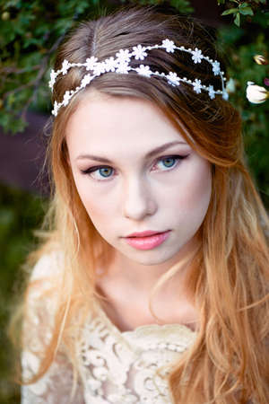 pleasantness: Close-up portrait of beautiful young girl with long blonde hair. Gentle and bright