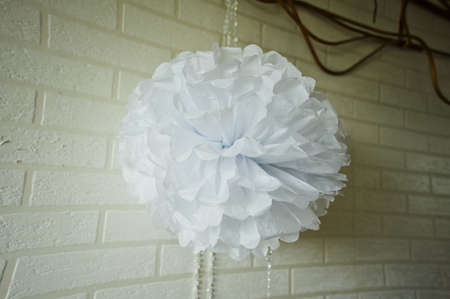 pompon: Paper white pompon for party, wedding. Close Stock Photo