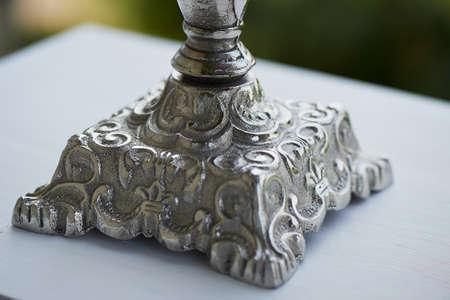 metal base: Silver metal base quality silver candlestick. Close Stock Photo