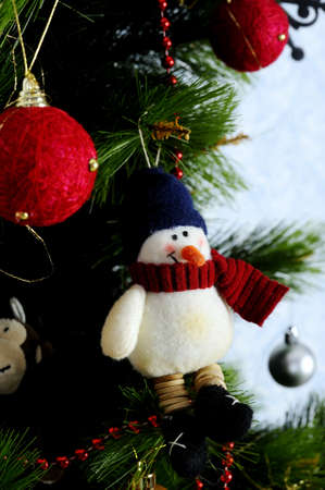 homely: Decoration toy snowman on the Christmas tree. A warm and homely atmosphere of a holiday Stock Photo
