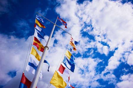 peterhof: SAINT-PETERSBURG, PETERHOF, RUSSIA - AUGUST 01, 2015: The flags on the pier of Peterhof Editorial