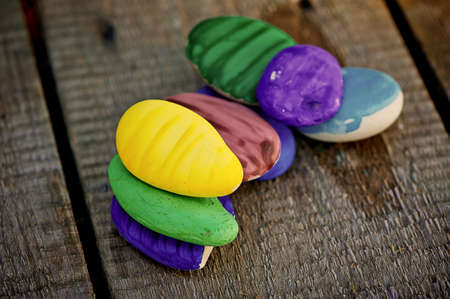 sea stones painted with paint in bright colors. Lot and close