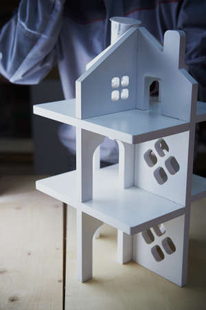 dollhouse: Painting white Dollhouse in the Studio. MDF