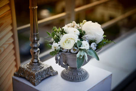 Wedding decor. Floral arrangement with berries white.Flowers. Old metal candle holder