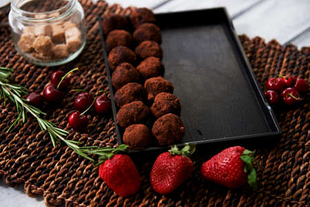 A lot of delicious round chocolate truffles. A work of culinary art