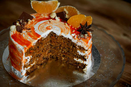 Carrot cake .Bright,juicy and unusual cake. Juicy and incredibly nutty A layer of caramel sponge cake successfully emphasizes. The pastry chef cut the cake. Stock Photo
