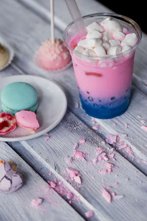 frothy: bubble tea in pink and blue color in a plastic Cup with a straw. Soft,beautiful colors