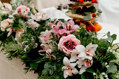Wedding table decoration newlyweds songs on the table of flowers stock photo wedding table decoration newlyweds songs on the table of flowerse pink and white palette rose orchid mightylinksfo