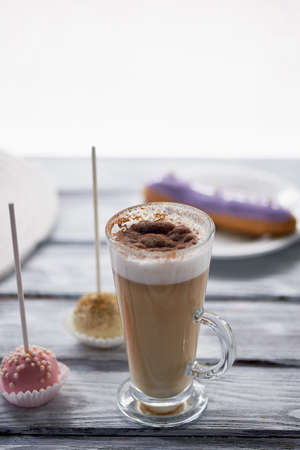 Coffee cappuccino with beautiful sweets on wooden background.Beautiful sweets Stock Photo