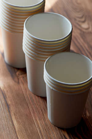 White disposable paper cups for coffee and tea. A lot.