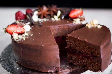 The chocolate cherry cake, decorated with strawberries, biscuits and strawberry shortcake.A masterpiece of culinary art